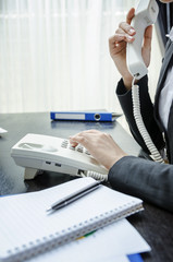 Business person using a telephone
