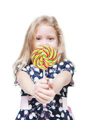 Little girl with lollipop isolated. Focus on candy