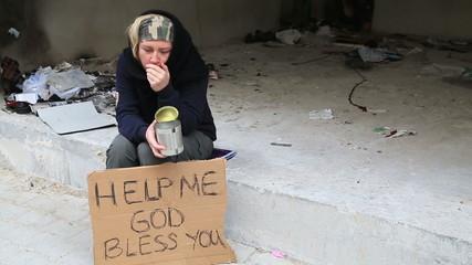 Homeless sick woman begging
