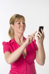 Blond woman using a mobile phone
