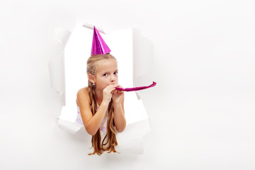 Little party girl with hat and whistle