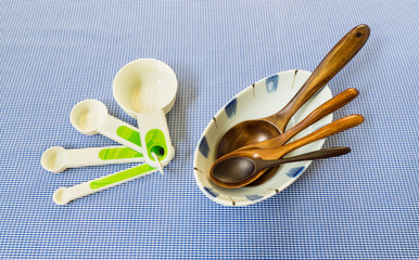 Measure Spoon Set with Four Wooden Spoon on White Bowl Placed on