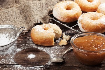 Homemade donuts on a wooden table