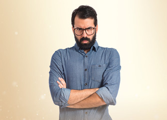 Young hipster man over isolated white background