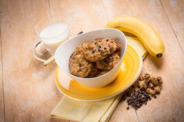 breakfast with chocolate cookie  muesli and banana