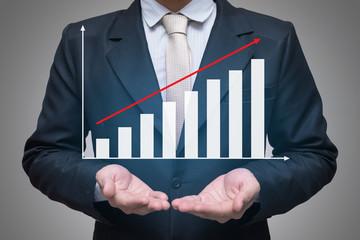 Businessman standing posture hand holding graph finance