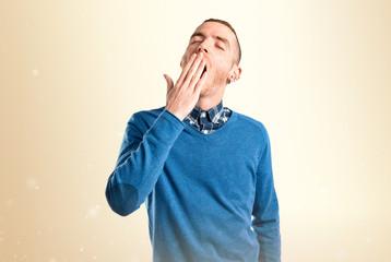 Redhead man yawning over isolated white background