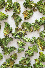 Baked Curly Kale Chips on Baking Tray Lined with Paper