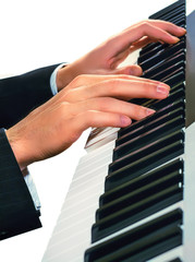Hands of musician. Pianist playing on a synthesizer, isolated on