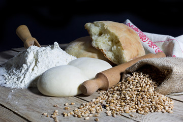 Flour,Dough,Bread,Rolling Pin and Jute Bag Filled with Wheat