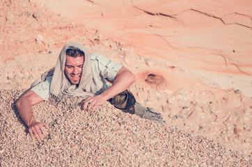 man struggling in the desert