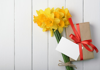 daffodils with a gift box