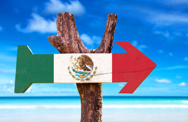 Mexico Flag wooden sign with a beach on background