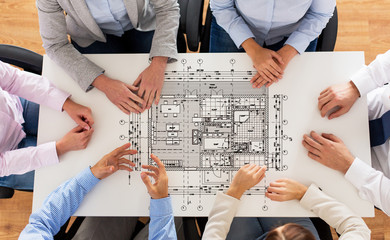 close up of business group with blueprint