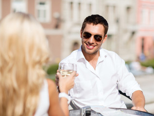 couple drinking wine in cafe