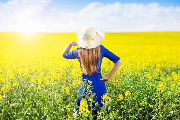 Woman in canola field