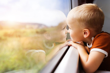Little boy travelling in train