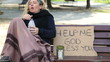 Homeless alcoholic woman drinking wine