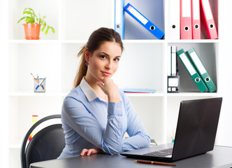 Attractive businesswoman working at computer in the office