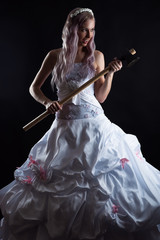 beautiful bride with ax in hand