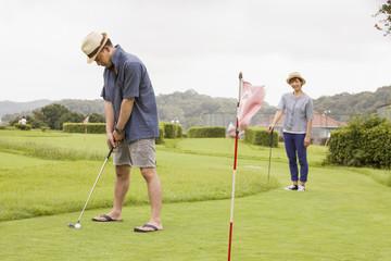 Couple on a golf course.