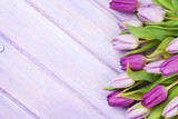 Fototapety Purple tulips over wooden table