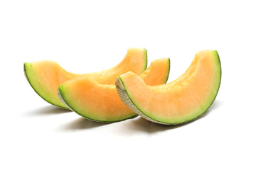 cantaloupe melon slices isolated on white background
