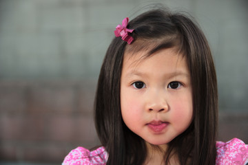 Asian female child in pink dress