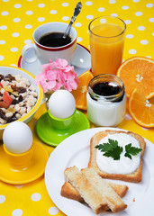 Breakfast with coffee,  eggs,  orange juice, muesli, yogurt