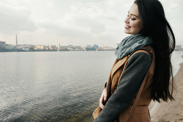 smiling woman near the river