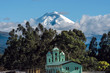 Cotopaxi volcano over the San Jaloma Church and Village, Andes