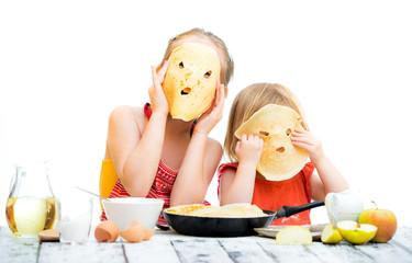 sisters cooking pancakes