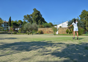 Playing tennis in a sunny day