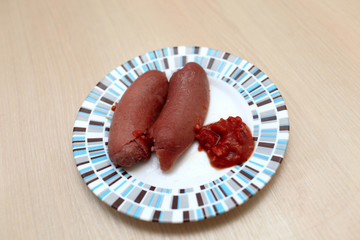 Sausages with ketchup
