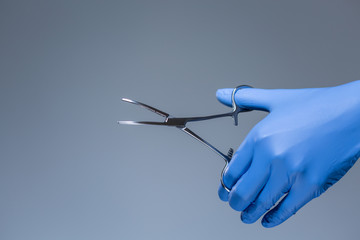 Close-up of scissors in the hand of doctor