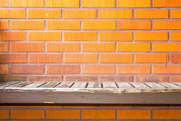 Okd worn bench on a brick wall