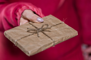Close up of woman giving package