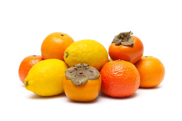 persimmons, tangerines and lemons isolated on white background