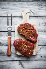 Raw meat on wooden background