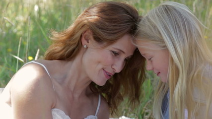 Mother and daughter sharing time together outdoors