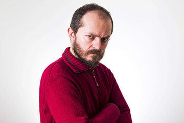 Portrait of angry man, in red sweater, with beard and mustaches