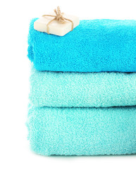 Stack of towels with soap isolated on white