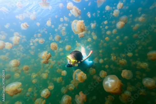 Tourist snorkeling in Jellyfish Lake