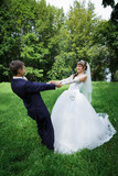 Bride and groom are dancing - 79520807