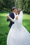 Bride and groom are dancing - 79520822