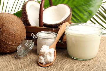 Coconut with jars of coconut oil and  milk