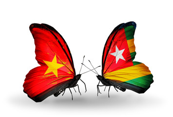 Two butterflies with flags Vietnam and Togo