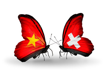 Two butterflies with flags Vietnam and Switzerland
