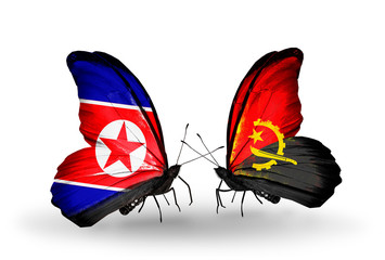 Two butterflies with flags North Korea and Angola