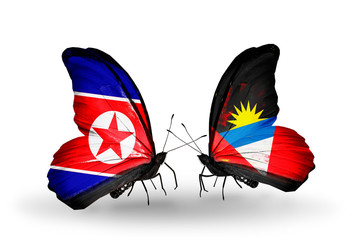 Two butterflies with flags North Korea and Antigua and Barbuda